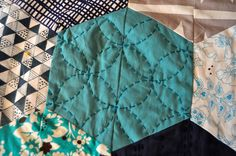 Sashiko in a patchwork quilt. Great color combo:  teal, black and white
