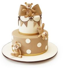 Tumbling Teddy Bears Baby Shower Cake This adorable brown and white baby shower cake includes a set of playful teddy bears tumbling down the face of the ca