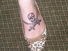 Love this jolly roger tattoo... on my ribcage of course