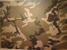 Jaydens room: How to paint a camo room 1. Used a woodland camo picture and projected on wall 2. Traced the pattern 3. Painted all walls with Benjamin Moore - Regal Select paint 4. Base coat all walls - Turret CC-604 egg shell finish 5. Next coat first layer of mural - Buckhorn CC-510 - Ulti-Matte finish 6. Next layer - Gloucester Sage - HC- 100 7. Final layer - Wrought Iron - 2124-10 8. Base boards and closet done in - Dune white - CC-70 use specialty paint brushes from an art store.