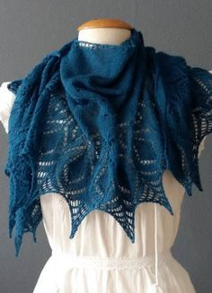 Knitting Pattern for Kitten One Skein Shawl - A crescent shaped lace shawl with some 'new' techniques for yarn overs. Uses just one skein of lace yarn.