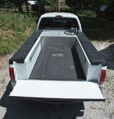 The bed is 49 inches wide to hold plywood-SR