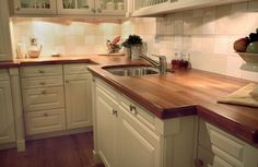 Antique white kitchen cabinets with butcher block countertops and Cost Of Countertops, Wooden Countertops, Outdoor Kitchen Countertops, Solid Surface Countertops, Butcher Block Countertops, Kitchen Counters, Countertop Options, Kitchen Islands, Cool Ideas