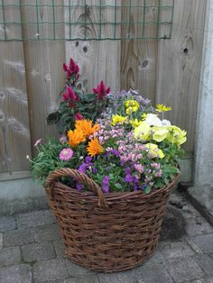 A basket full of flowers...I'd like them around in diff places