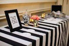 black and white table linens | see more winter wedding themes for your tablescapes here: http://www.mywedding.com/articles/5-winter-wedding-themes-for-your-tablescapes/