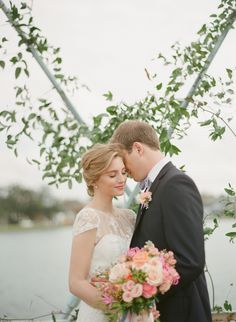 Bride and groom on a garland decorated bridge! Greer g photography, tying the knot wedding coordination, Kim start wise florals