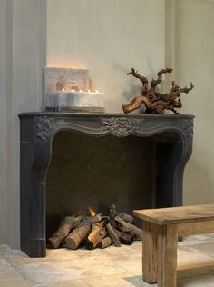 antique meets modern: love the distressed black fireplace