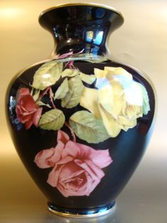 Thomas Ivory black porcelain vase hand painted with roses in full bloom, 1939-1952