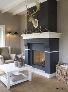 Not so sure about the dead animal parts scattered across the fireplace (and above it), but otherwise very pretty. Cozy Living, My Living Room, Home And Living, Living Room Decor, Bedroom Decor, Home Interior, Interior Design Living Room, Living Room Designs, Interior Livingroom