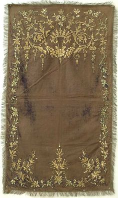 Purple Velvet Wall Hanging A distressed purple velvet hanging with an exuberant floral design with a top center urn. Metallic gold couching using card board filler for three dimensional effect.