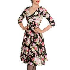 Floral pin up dress!! Floral black and pink Stretchy comfy material  Gorgeous pin up detail Camo belt around waist Super cute and vintage New with tag I also have a white petti coat i can sell separately lmk Dress states small but fits a perfect medium instead Dresses