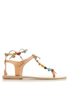 Traditional techniques meet feminine detail in Ancient Greek Sandals's handcrafted footwear. This camel-brown leather Chrysso pair is shaped with a toe separator and a slim front strap, and decorated with strings of multicoloured stones that wrap around the foot and ankle. Show off the embellishment with ankle-cuffed trousers.