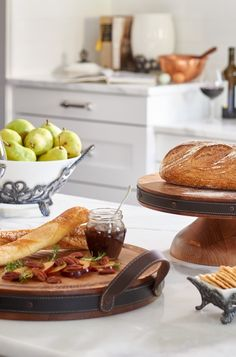 Boasting heft and 19th century European appeal, the versatile Heritage Viande Board with Leather Handles doubles as a cutting board and serving platter.