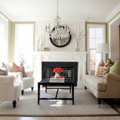 Fireplace, mantle, mirror, chandelier, green wall paint--Love