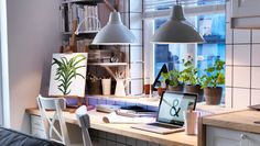 See your home in the best light. Sometimes your desk is your kitchen worktop and dining table, too. See how the right lighting can help it do a good job at being all three.