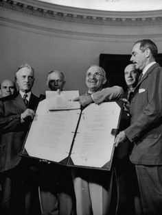 Harry S. Truman Displaying Surrender Documents from Japanese with US Sec of State Henry L. Stimson