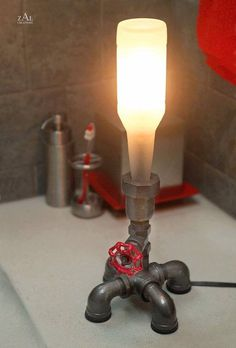 Steampunk lamps from plumbing pipes and beer bottles