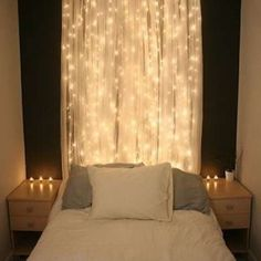 Hang string lights over a dark-painted wall, with sheer curtains to soften and diffuse the effect. This headboard definitely lights up the night.