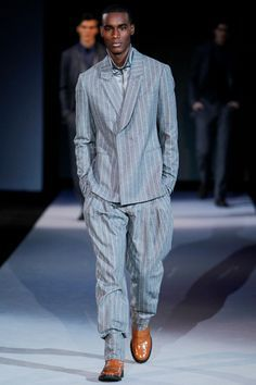 This modern day zoot suit is part of Giorgio Armani's collection. The zoot suit was worn by young African and Mexican Americans in the 1940s. They served as a sign of rebellion.