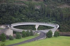 THE WORLD GEOGRAPHY: 12 Most Unusual Bridges of the World - 2. Hureai Bridge, Japan photo source This unique circular pedestrian bridge is located at the foot of the Hiyoshi dam near Kyoto, Japan. It is part of  Hiyoshi Spring spa resort and was designed by Japanese architect Norihiko Dan, who also planned the landscaping of the spa resort and park.