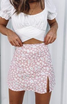 Get Summer ready in the Laura Skirt Pink Print! This cute piece styles perfectly with a white crop and sneakers for a relaxed Summer look. Pink floral mini skirt Fitted design Invisible back zip Slit on the thigh Linen-like material Unlined outfits Teen Fashion Outfits, Girly Outfits, Look Fashion, Pretty Outfits, Fashion Ideas, White Girl Outfits, Spring Fashion, Fashion Dresses, 80s Fashion