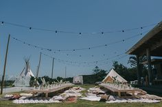 {Real Wedding} Lizzy + Johnny's relaxed luxe bohemian lovefest // Low tables, teepees + festoons for the lovely Spell Designs in Byron Bay    Created by The Events Lounge www.theeventslounge.com.au