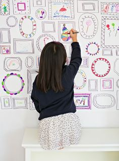 white contact paper on the wall. Use sharpie to draw frames. Let kids doodle!