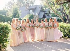 Long bridesmaid dresses in different shades of pink.