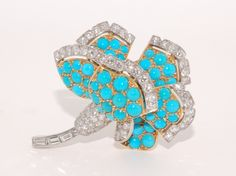 Cartier turquoise and diamond flower pin