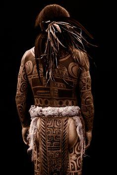 Tattooed Tahitian man, from the book Tahiti: Faery Lands by François Nars.