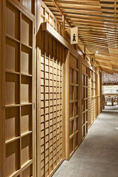 interesting WC entrance at japanese restaurant: Dual Design In Spain Inspired By Japanese Culture:Nozomi Sushi Bar - http://freshome.com/dual-design-spain-inspired-by-japanese-culture-nozomi-sushi-bar