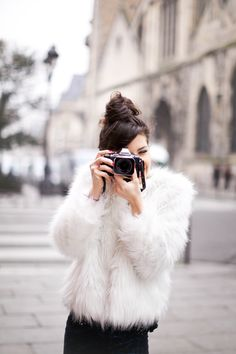 Fluffy white jacket and camera!