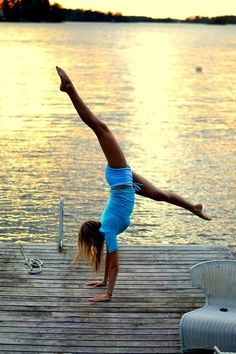 Handstand...my goal for this summer...need to borrow the pier of a lake friend...MOLLY!!!!