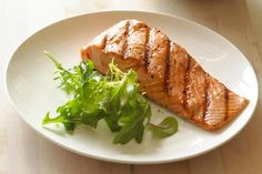 An easy and simple recipe for grilled salmon that give you both the cool grill marks on the meat and a crispy skin. These tips on grilling salmon will work with any kind: farmed, kings, sockeye or silver.