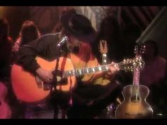 My 'guitar god' Stevie Ray Vaughan - Powerful Electric and Amazing Acoustic... Great Stevie Ray moments onstage with Double Trouble. Includes some rare footage of Stevie onstage playing the double neck with Santana. Just great playing! Listen to what Eric Clapton and Buddy Guy have to say about him in this video.