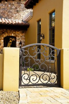 Custom Iron Gate Goes with many architectural styles and eras. Would prefer it with a vertical or so. Iron Garden Gates, Garden Doors, Gates And Railings, Porte Cochere, Front Courtyard, Wrought Iron Gates, Entry Gates, Gate Design, House Design