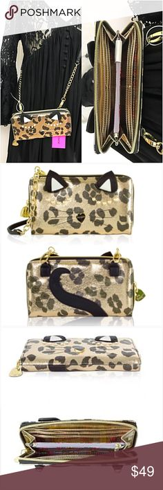 "NWT Betsey Johnson Cheetah Kitty Crossbody Wallet MEOW 🐱 Adorable Betsey Johnson Sleeping Kitty Cheetah Wallet on a String Crossbody.   • Soft Faux Gold Leather  • Sleeping Kitty Eye Design • Zip around closure • Signature Betsey Johnson Heart Logo • Gold Metallic Interior With Coin Zip Pocket Bill Pockets 8 Card Slots & ID Slot • Detachable Chain Detail 23"" Drop Strap • 8"" x 4.5"" x 1""  • NEW WITH TAGS Betsey Johnson Bags"