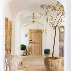 """I have had the most wonderful start to my sunday, enjoyed my morning coffee in bed with my copy of Brooke and Steve Gianetti's fantastic book """"Patina Farm"""" starring their amazing home in Ojai, California. There is nothing I don't love about it! Both the home and the book. Shown on the picture is the entrance hall with vaulted ceiling and reclaimed antique door in the back. @velvetandlinen photography by @lisaromerein @philippvogtinteriors #philippvogtinteriors #munich #adelgundenstrasse16…"""