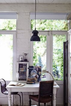 painted brick + sunroom + french doors + rustic