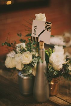 metallic centerpiece with simple table number // photo by Fondly Forever // florals by The Pollen Project