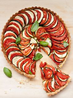Tomato & Zucchini Tart -- pate brisee crust blind-baked and filled with fresh tomatoes, zucchini, basil oil and Parmesan cheese.