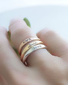 Engraved ring by Olive Yew. This engraved ring is adorable & comes in silver, gold or rose gold. Engrave a name, date or symbol to customize these especially for you! Engraved Jewelry, Engraved Rings, Personalized Jewelry, Personalized Wedding, Wedding Band Engraving, Piercings, Name Jewelry, Rose Gold Jewelry, Antique Engagement Rings