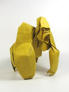 My entry for OUSA chalenge 2009 - an angry Gorilla. It took me about a week to design the head and a month for the whole model.  Creator: Nguyễn Hùng Cường Designed & folded: April 2009 Material: one uncut square of crumpled paper