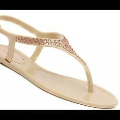 Nine West jelly kiss nude crystal sandal Brand new with tags. Colors available: nude and black. Sizes available in nude: 5, 6, 7, & 8. Sizes available in black: 5. All crystals are still attached. Adjustable ankle strap. Perfect for the pool and beach when the weather warms up. Nine West jelly kiss nude crystal sandal Nine West Shoes Sandals
