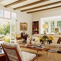 A family room that is both lived in and full of light. I like the direct access to the outside and the built in bookshelf.