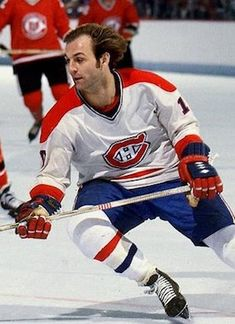 "Before Marc-Andre Fleury, the real ""flower"" power was Guy Lafleur Hockey Shirts, Hockey Mom, Hockey Teams, Ice Hockey, Montreal Canadiens, Mtl Canadiens, Baseball Scores, Nfl Fans, National Hockey League"