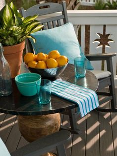 2013 HGTV Smart Home Front Yard Pictures. An oxidized iron-clad wood table is set for a midday snack. Blown-glass tableware, pottery and linens hint at the interior color palette. Bedroom Pictures, Living Room Pictures, Tree Cut Out, Blue Siding, Game Room Basement, Outdoor Rocking Chairs, Front Yard Design, Manufactured Stone, Jacksonville Beach