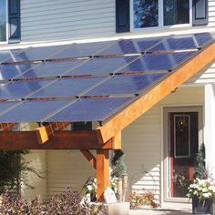 Applying solar panels to your timber frame porch can provide shade and energy. By TFBC member Heirloom Timber Framing