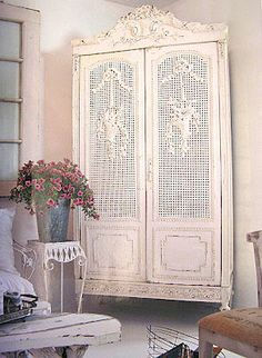 French armoire w/cane doors and beautiful detail.