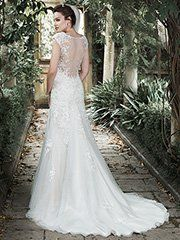 Maggie Sottero - ALMUDENA, A stunning illusion back; adorned with embellished lace appliques; adds a dose of drama to this otherwise understated A-line wedding dress. Sequined lace appliques cascade down a tulle skirt; creating a lovely romantic silhouette. Finished with sweetheart neckline and side zipper with inner lap closure.